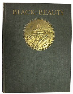 Cover of Black Beauty Book with gilt title and portrait of Black Beauty and Ginger.